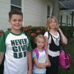 Here's all three kids on their first day of school -- and Drew's shirt says it all! :)