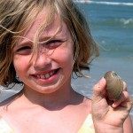 Alex LOVES collecting shells at the beach!